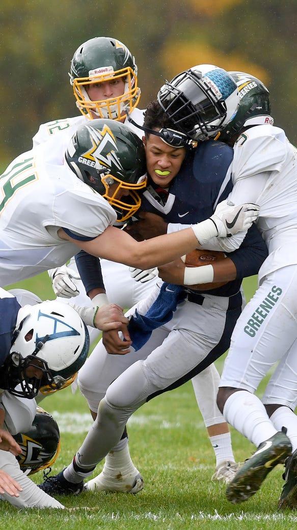 Asheville School's Ahmad Galimore loses his helmet