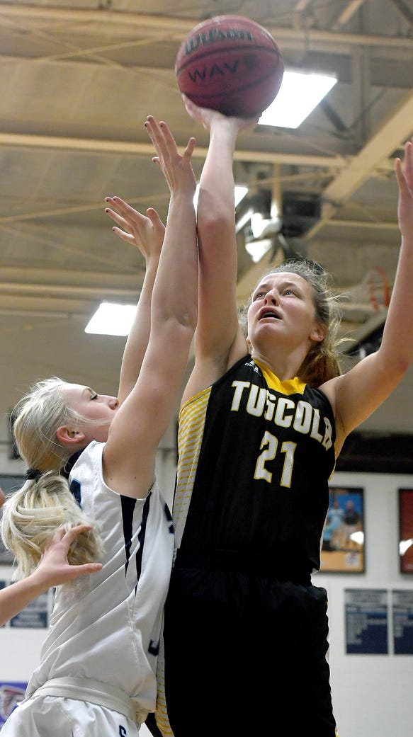 Tuscola's Shelby Glance goes up for a shot against