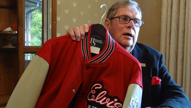 Ed Dougherty, a former concert and event promoter, shows off an Elvis Presley tour jacket that will be among the items from his personal collection that will be available Saturday. concert and event promoter, is parting with much of his memorabilia during an auction on Saturday, May 10, 2014.