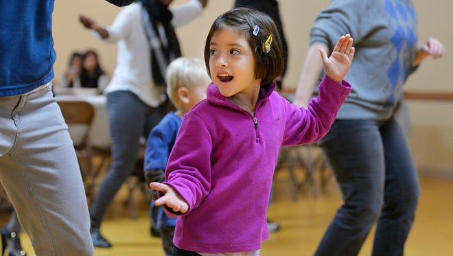 Anelie Gonzalez, 4, Melrose, tries her hand at Zumba during a CentraCare Health-sponsored event Sunday, November 22 at Martinez Meat & Grocery in Melrose designed to help the Hispanic community avoid diabetes and cook healthy meals.