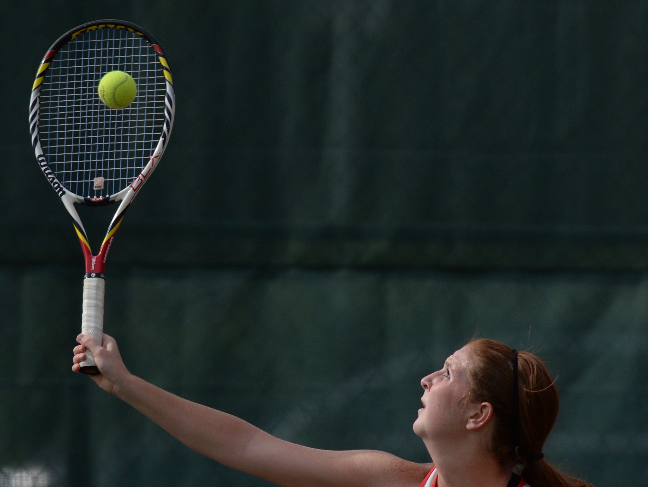 Richmond's Kaitlyn Harrison serves the ball during her No. 1 singles match Friday.