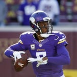 Minnesota Vikings quarterbacks Teddy Bridgewater takes snaps during warmups On Nov. 8 before the game against the St. Louis Rams in Minneapolis.