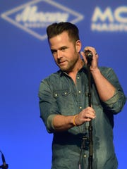 David Nail performs during Team UMG at The Ryman as part of CRS 2014 on February 19, 2014 at the Ryman Auditorium in Nashville, Tennessee.