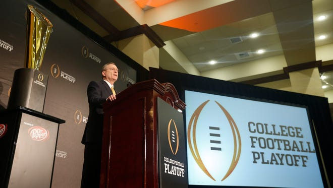 College football playoff selection committee chairman Jeff Long speaks to the media at the Gaylord Texan Hotel.
