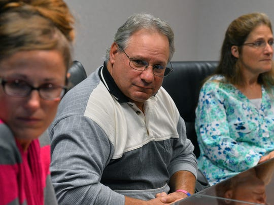 Michelle Guilford, Brian Guilford and wife Becky, left