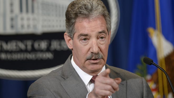 Deputy Attorney General James Cole gestures during a news conference at the Justice Department in Washington, Wednesday, April 23, 2014. Cole announced the new standards that will be considered in deciding whether to recommend clemency for certain non-violent drug prisoners.