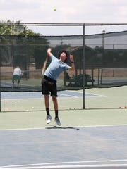 Aaron Overstreet loads up for a serve during the Saturday portion of the Cavern City Adult Tennis Tournament.