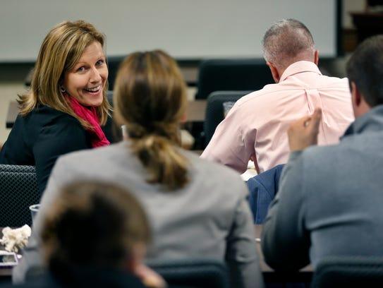 Financial advisor Jill Knittel and co-workers wait