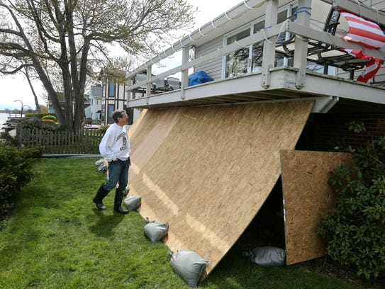 Bill Joyce, who lives on Old Edgemere Drive, used plywood