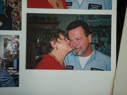 """Lorraine Talarico-Smith kisses her late husband, Thomas """"Smitty"""" Smith, in an old photo."""