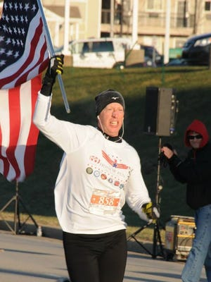 Dr. Robert Tagher, of Walton, came in 11th place in the Inaugural Honor Run Half Marathon in Florence. Organizer Scott Spicher plans to hold the event each year on the weekend following Veterans Day.