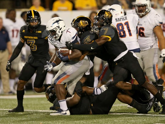 UTEP Miners running back Kevin Dove (15) is tackled by the Southern Miss Golden Eagles defense in the first half at M. M. Roberts Stadium. Mandatory Credit: Chuck Cook-USA TODAY Sports