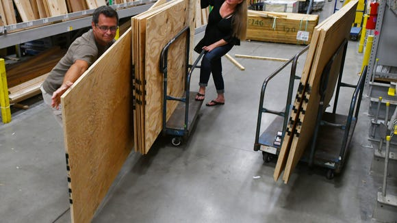 """We are crossing our fingers"". says Wes and Davina Hardin of Palm Bay, buying plywood and other hurricane supplies on Labor Day Monday at the Melbourne Lowe's Home Improvement Store on Minton Road."