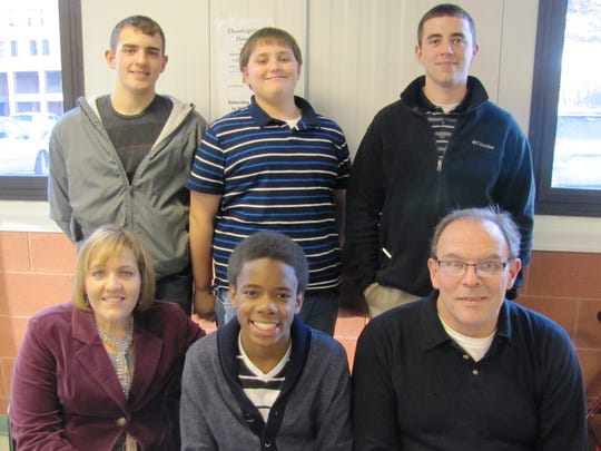 Rashad Burns, 14, became a permanent part of the Ravert family of Elmira on Friday following an adoption ceremony. He is seated with his parents, Kitty and Clayton Ravert of Elmira. Standing, from left, are his brothers, Adam, 19, Aaron, 14, and Tyler, 24. Missing is his older sister, who is married and lives in Maryland.
