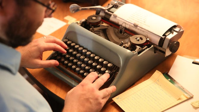 A writer uses a typewriter to write a love letter to Cincinnati.