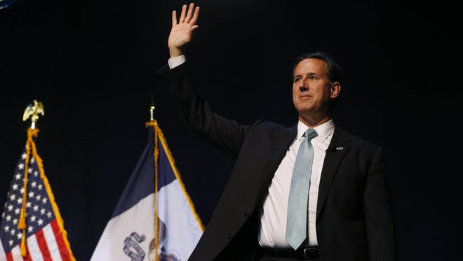 Republican presidential candidate Rick Santorum waves to the Saturday, Sept. 19, 2015 during the Faith & Freedom Coalition fall dinner at the Paul Knapp Center in Des Moines.