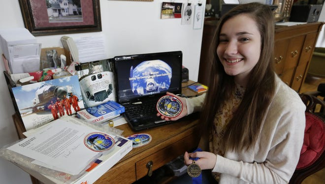 Sonja Karner, an eighth-grader at Webster Stanley Middle School, shows off some of the memorabilia she has received from the astronauts from the STS-71 mission.  She is headed to the national round of the National History Day Project competition in Washington D.C.  Her project is 10-minute documentary on the USA/Russian STS-71 mission in 1995.