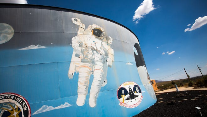 A water tank is painted with scenes from NASA's history at the Space Murals Museum off U.S. 70 in Organ, New Mexico.