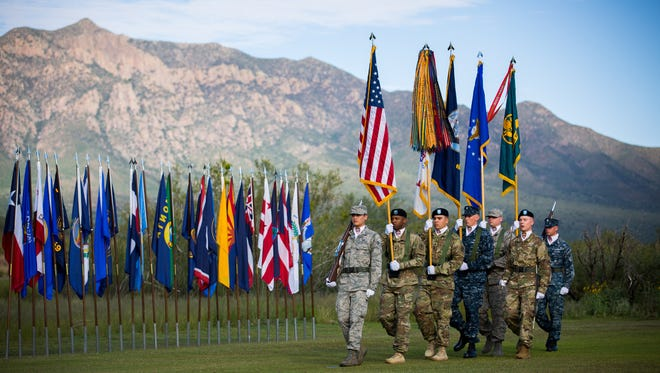 Members of the Color Guard march during the White Sands Missile Range Change of Command ceremony, Thursday, August 25, 2016.