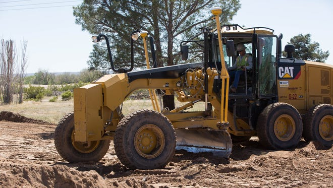 Work crews from Morrow Enterprises inc. started the processes of grating a road on what once was the Las Cruces Country Club property. Thursday, March 30, 2017.