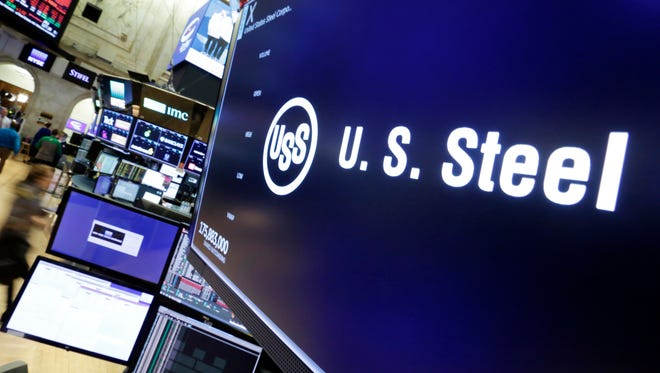 "The logo for U.S. Steel appears above a trading post on the floor of the New York Stock Exchange on Friday. President Donald Trump on Friday insisted ""trade wars are good, and easy to win,"" a bold claim that will likely find many skeptics, including those on Wall Street and even some Republicans."