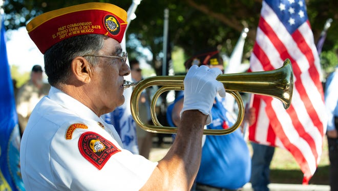 "Veteran Ray Rivera plays, ""Taps,"" on Sunday, May 27, 2018, during tenth annual The American Legion Post 10 wreath memorial at St. Joseph's Cemetery."