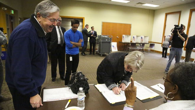 Chris Branstad checks in at her polling place as the Governor jokes with a poll worker about already voting. Gov. Branstad accompanied First Lady Chris Branstad as she voted  Tuesday, November 4, 2014, at Plymouth Congregational Church, Des Moines, IA. The Governor voted early through an absentee ballot.