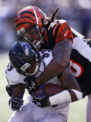 Bengals middle linebacker Rey Maualuga  tackles Baltimore Ravens wide receiver Steve Smith in September of 2014.
