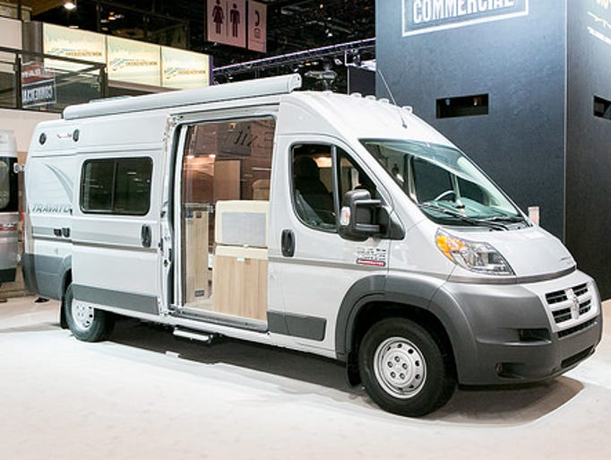 "The 2014 Winnebago Travato Class B motorhome built on Chrysler's Ram ProMaster commercial van chassis unveiled at the Chicago Auto Show. The outside features an awning, TV cable hookup and power outlets for the ""patio."""