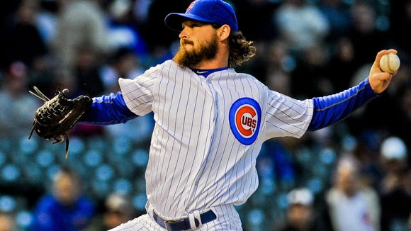 Cubs starting pitcher Travis Wood pitches in the first inning Wednesday night against the Cincinnati Reds at Wrigley Field.
