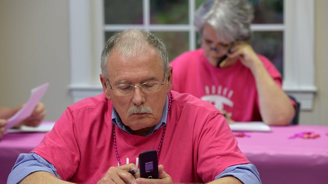Volunteer Terry Conlon dials voters on behalf of the Planned Parenthood Votes and Planned Parenthood Health Systems Action Fund from their call center in Raleigh, N.C. The volunteers are encouraging voters to support Sen. Kay Hagan, D-N.C.