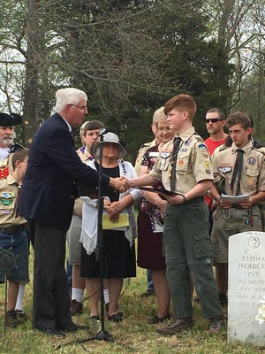 George Swales, vice president of the Ozarks Mountain Chapter of the Sons of the American Revolution, thanks Nixa Boy Scout Cooper Terry for his work on the Old Salem Cemetery, where two Revolutionary War veterans are buried.