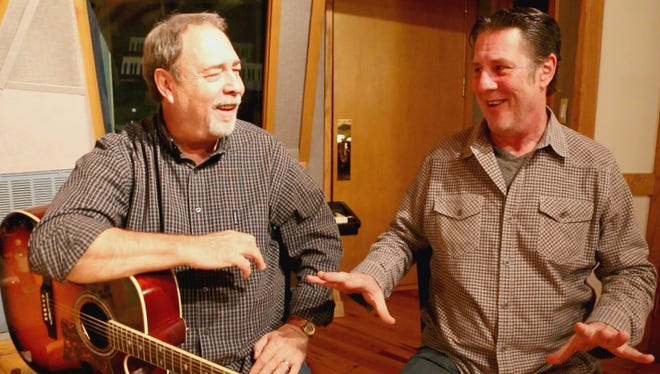 """Jim McBride, left, tells Bart Herbison about writing """"Chasin' That Neon Rainbow"""" with Alan Jackson."""