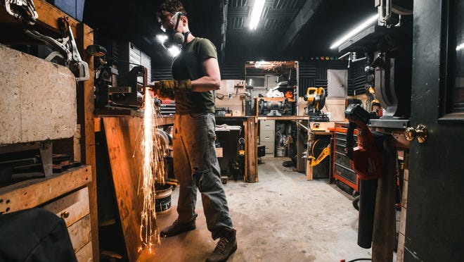 """Keaton Goddard, who will appear on """"Forged in Fire"""" ednesday, works at his shop, Faraway Forge, in Nantucket."""