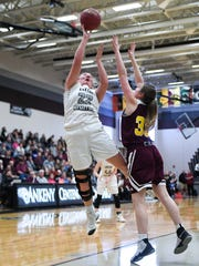 Ankeny's Isabelle Vacek (35) defends as Centennial's