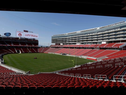 FILE - In this July 17, 2014, file photo, a groundskeeper drives across the field before the ribbon-cutting and opening of Levi's Stadium, in Santa Clara, Calif. The San Francisco 49ers prepare for their first preseason game at new Levi's Stadium on Sunday when they host the Denver Broncos.(AP Photo/Eric Risberg, File)