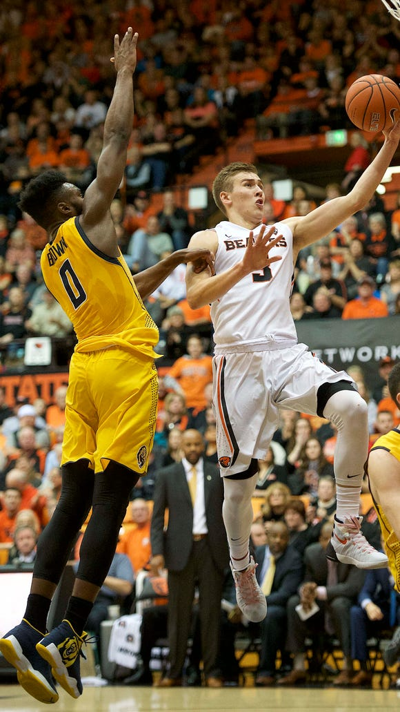 Jan 9, 2016; Corvallis, OR, USA; Oregon State forward Tres Tinkle (3) shoots the ball past California forward Jaylen Brown (0) at Gill Coliseum.