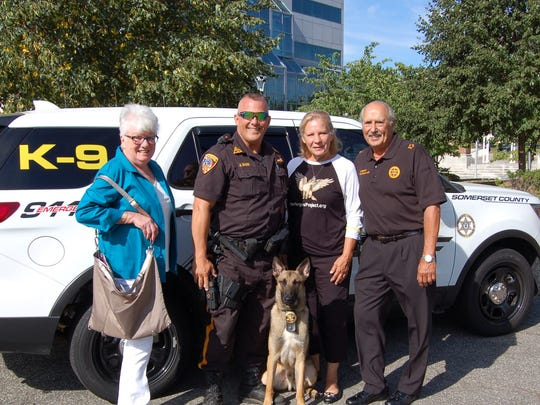 Somerset County Sheriff Frank J. Provenzano (right) welcomes Billy to the K-9 Unit team. K-9 Billy and his handler are arson investigators. Billy was donated by K-9 Soldiers Inc., operated by J.T. Gabriel in Frenchtown. Pictured are (left) Jane Manzio, Sheriff's Officer Albert Bauer, K-9 Billy and J.T. Gabriel.  Billy was named for Ms. Manzio's brother who served in the U.S. Army and was a Vietnam veteran.