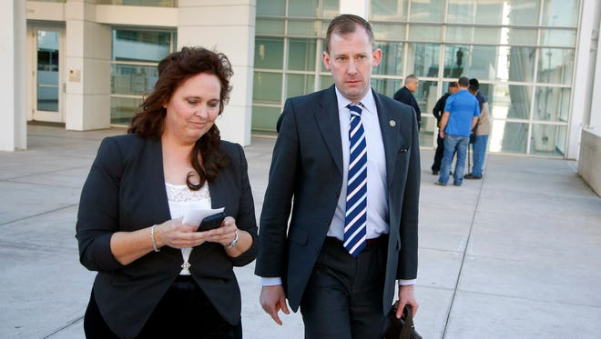 Charlene Jeffs, left, the former sister-in-law of Warren Jeffs, church leader of the Fundamentalist Church of Jesus Christ of Latter Day Saints sect, walks with U.S. Justice Department attorney Sean Keveney, right, as they leave the Sandra Day O'Connor United States District Court together after her day of testimony during a federal civil rights trial against two polygamous towns on the Arizona-Utah line Wednesday, Jan. 27, 2016, in Phoenix.