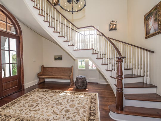 The foyer features a beautiful winding staircase.