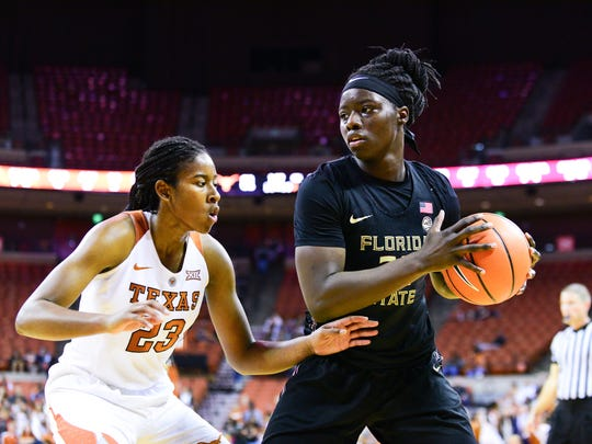 Florida State senior forward Shakayla Thomas (20) prepares to hand off the ball during the final minutes of the game against Texas.