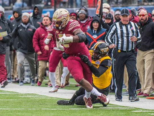 Florida State junior running back Jacques Patrick breaks