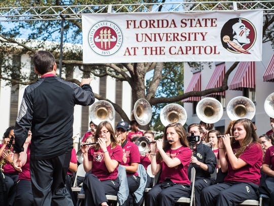Dr. David Plack leads the Marching Chiefs during the