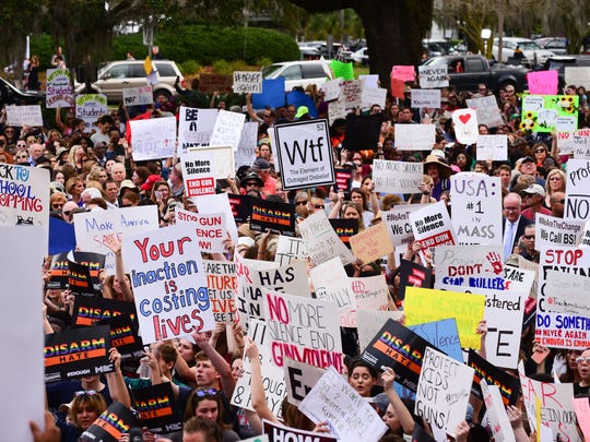Protesters gathered outside of the Florida Capitol Building, Wednesday, in support of gun reform. The protest comes one week after the shooting in Parkland, Fla. at Marjory Stoneman Douglas High School, that left 17 people dead.