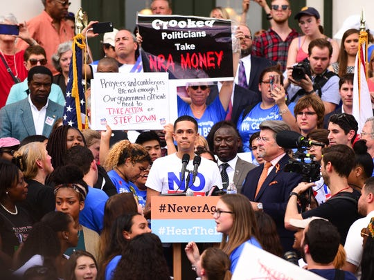 """Brandon Wolfe, a survivor of the Pulse Nightclub massacre, addresses the crowd at the rally in Tallahassee, Florida on Wednesday alongside students from Marjory Stoneman Douglas High School. """"Do your job, or stay out of our way!"""" he emphasized to the crowd and to lawmakers in attendance."""