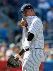 Yankees reliever Dellin Betances reacts after walking