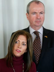 Governor-elect Phil Murphy stands by as his wife Tammy