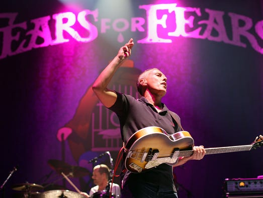 Curt Smith of Tears For Fears performs on stage during