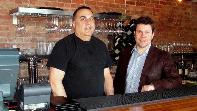 Architect Chad Chalmers, right, an Elmira native, helped Louie's Restaurant owner Jim Ferratella redesign and expand his popular Horseheads restaurant.