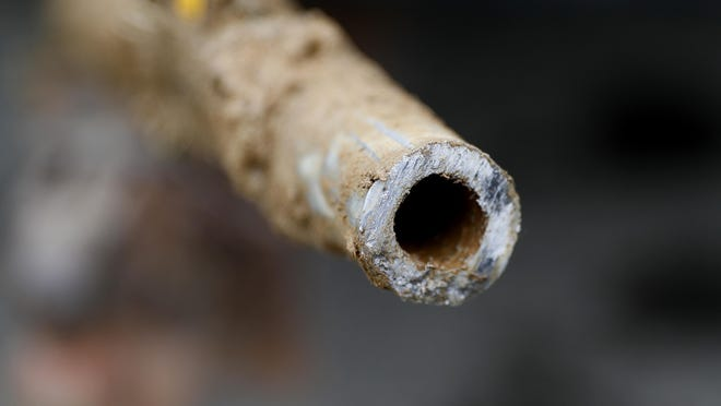 A lead pipe is shown July 20, 2018, after being replaced by a copper water supply line to a home in Flint. Gov. Gretchen Whitmer announced a $500 million plan Thursday to upgrade drinking water and wastewater infrastructure in Michigan with actions such as replacing lead service lines and removing chemical pollutants.
